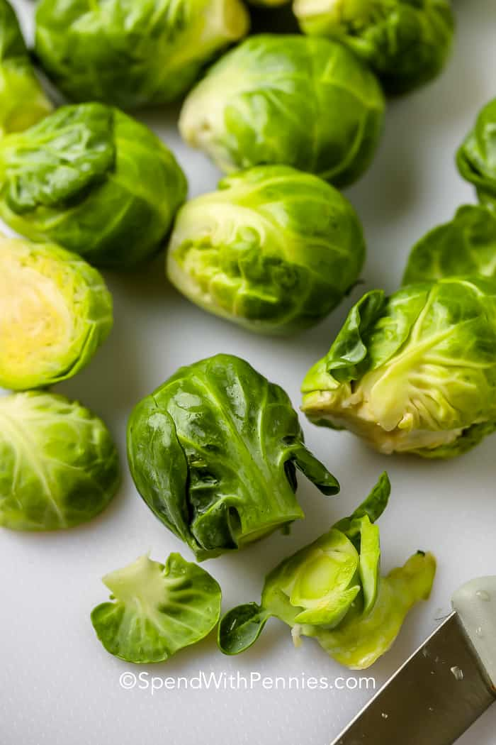 Sliced brussel sprouts on a cutting board
