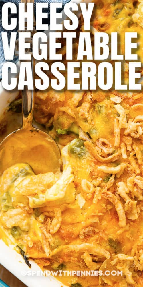 Cheesy Vegetable Casserole with a spoon and writing