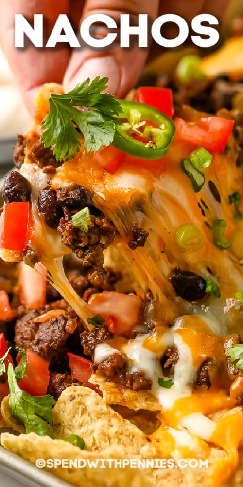 Nachos being scooped off a sheet pan with a title
