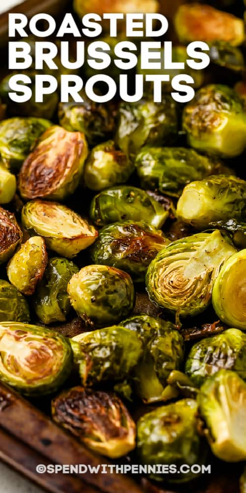 Roasted Brussels Sprouts on a baking sheet with writing