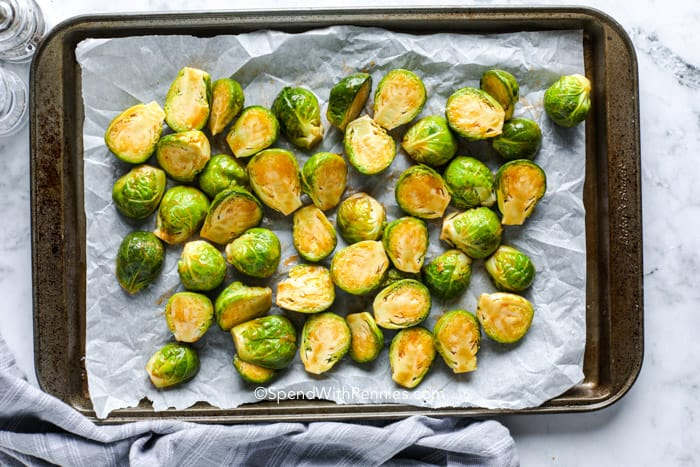 Sriracha Honey Brussels Sprouts on a sheet pan with parchment paper