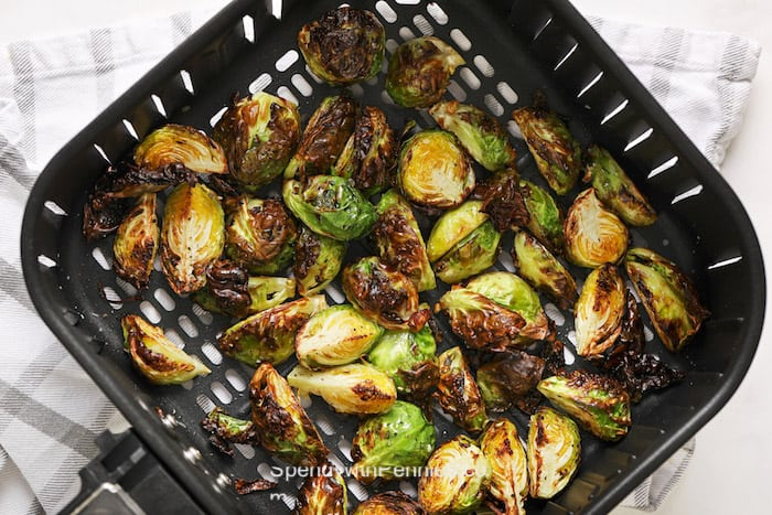 Cooked brussels sprouts in an air fryer basket