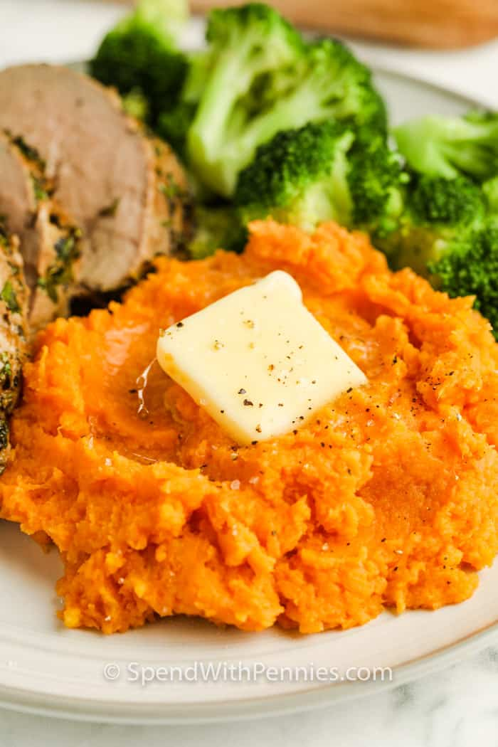 mashed Boiled Sweet Potatoes on a plate with broccoli and meat