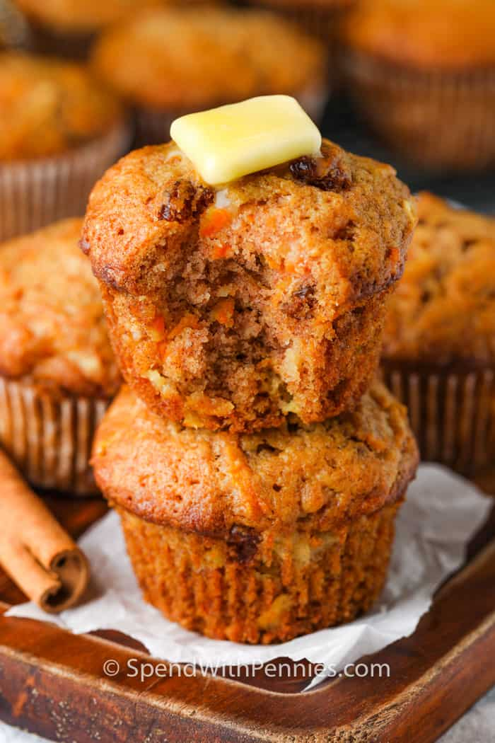 Carrot Muffins stacked with butter melted