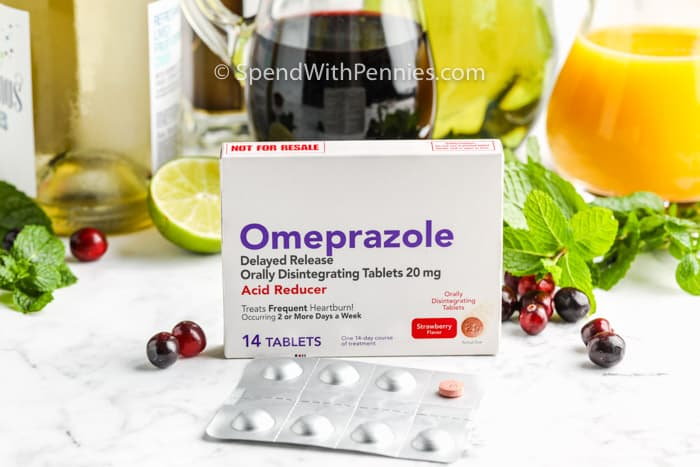 pack of Omeprazole with ingredients to make Champagne Punch in the background