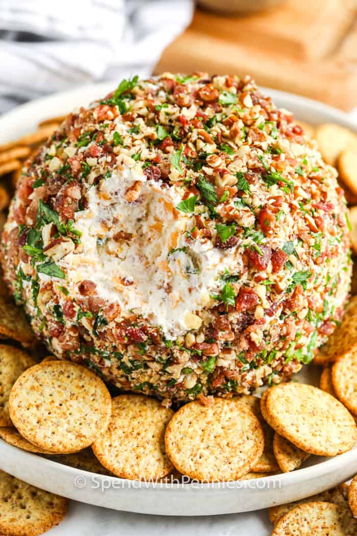 Classic Cheese Ball with crackers on a plate