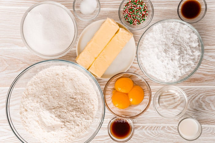 ingredients for baking cookies on a wood board