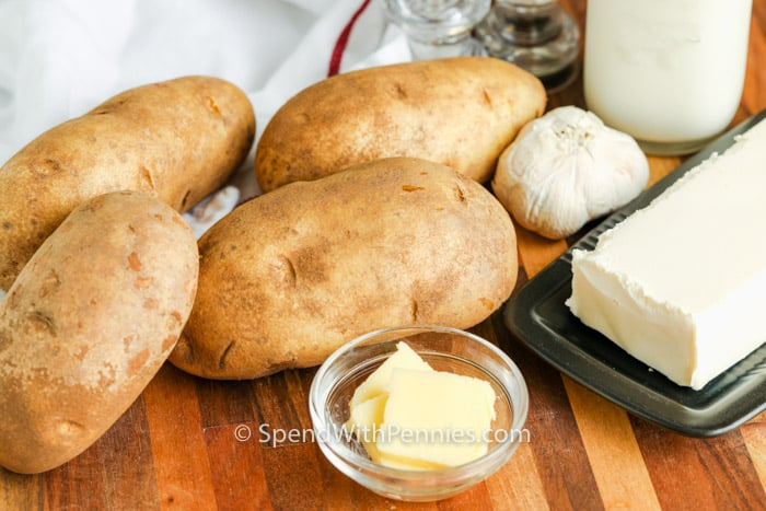 ingredients to make Cream Cheese Mashed Potatoes on a table