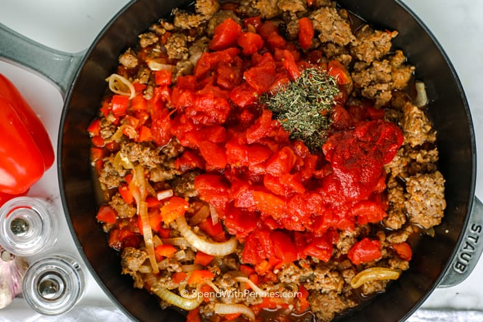 sausage and tomatoes in a pan for pasta