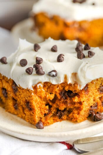 close up of a slice of Chocolate Chip Pumpkin Cake on a plate with a bite taken out of it