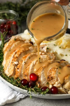 Gravy being poured over a turkey breast
