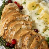 A turkey breast with gravy on a plate