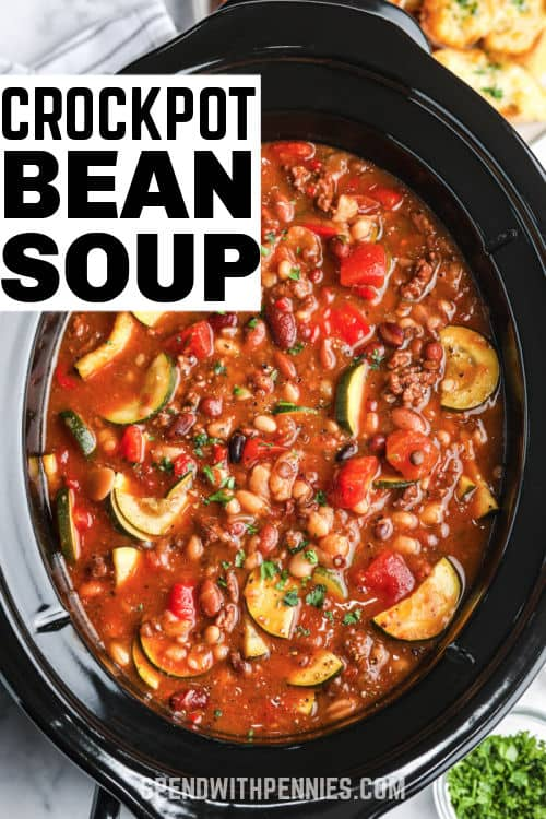 Crock Pot Italian Bean Soup in the crockpot after cooking with writing