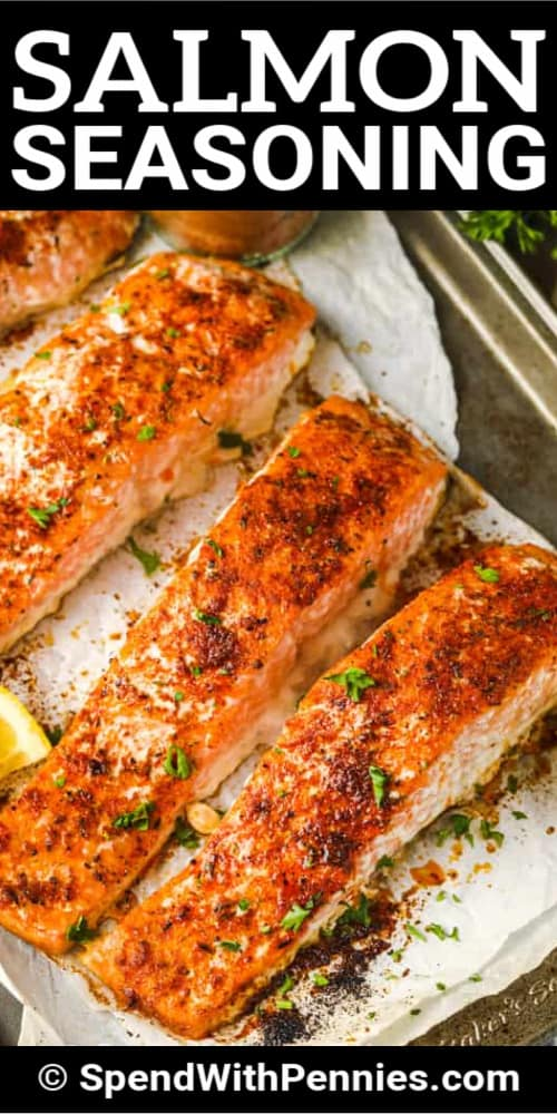 Salmon cooked with Salmon Seasoning on parchment paper with a title.