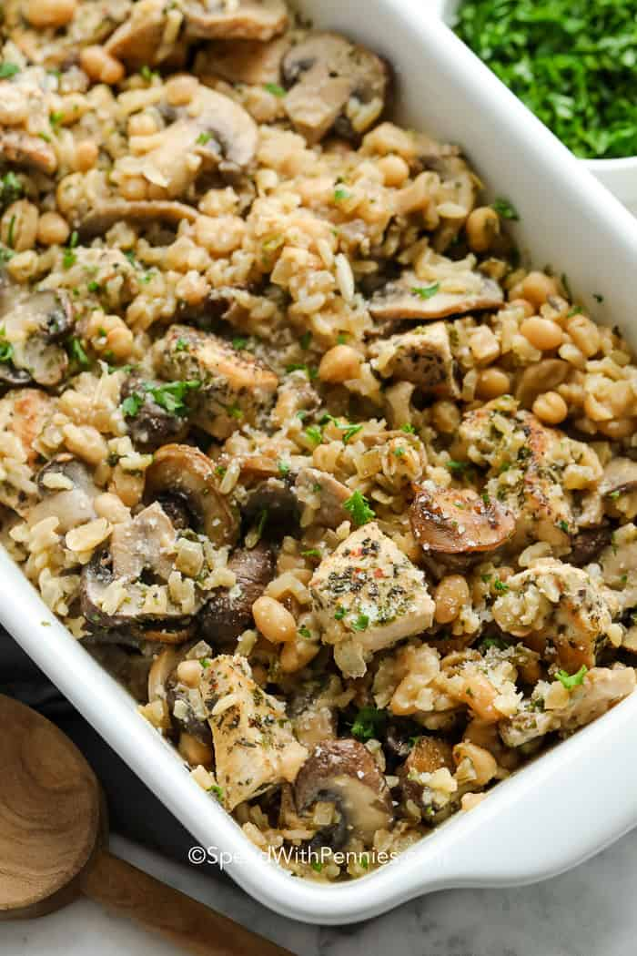 Chicken mushroom casserole in a white dish with parsley