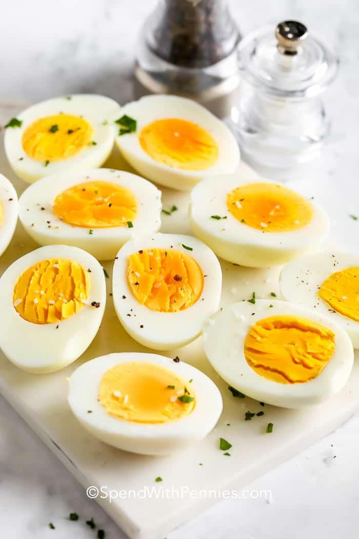 Air Fryer Boiled Eggs cut in half on a marble board