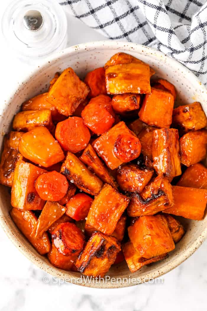 top view of Air Fryer Roasted Sweet Potatoes and Carrots glazed in a bowl