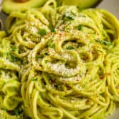 Avocado Pasta on a plate with avocado on the side