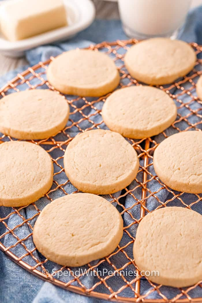 Butter Cookies on a cooling rack with butter and milk in the background
