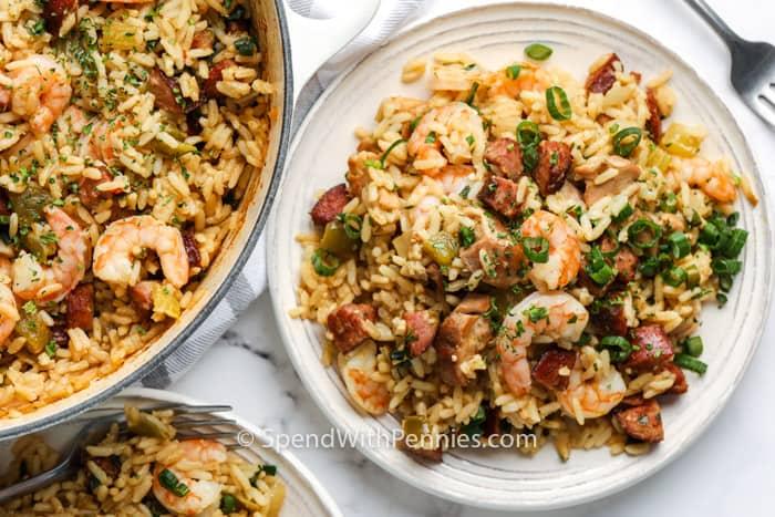 Cajun Jambalaya with a fork and bowl full of Cajun Jambalaya beside it
