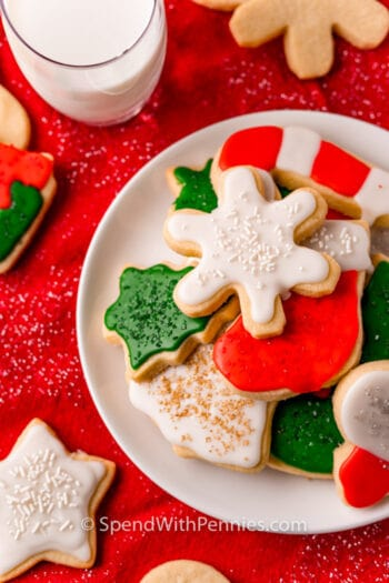 Christmas Cut Out Cookies on a plate with a glass of milk