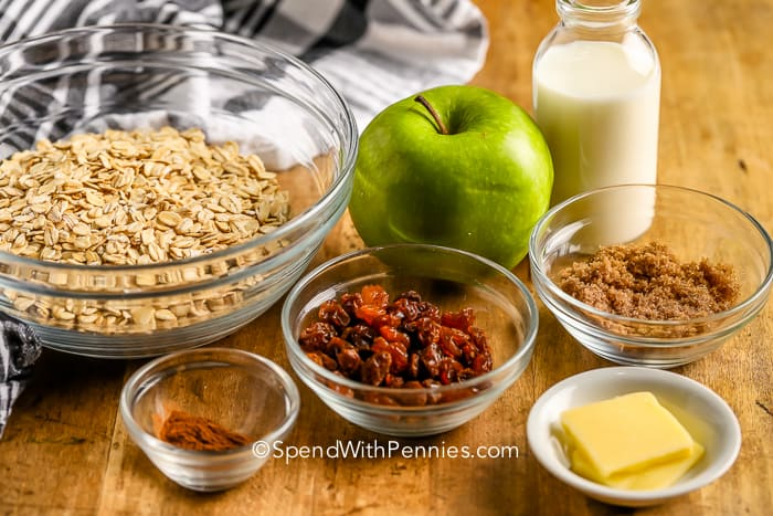 ingredients for Cinnamon Apple Oatmeal on a wooden board
