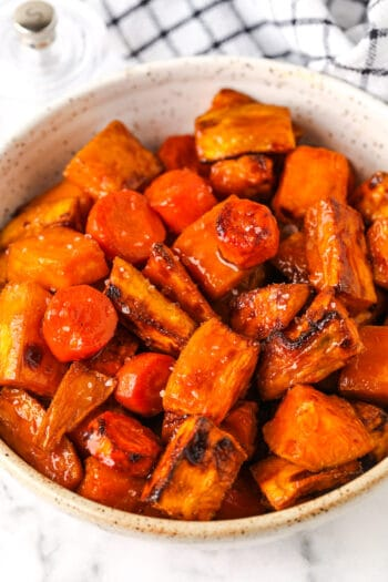 close up of Air Fryer Roasted Sweet Potatoes and Carrots glazed in a bowl