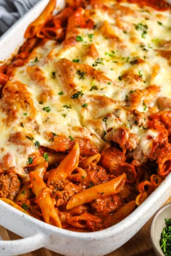 cooked Creamy Baked Mostaccioli in a white casserole dish