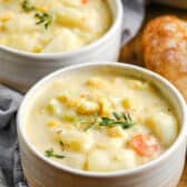 bowls of Quick Potato Corn Chowder with a loaf of bread beside it