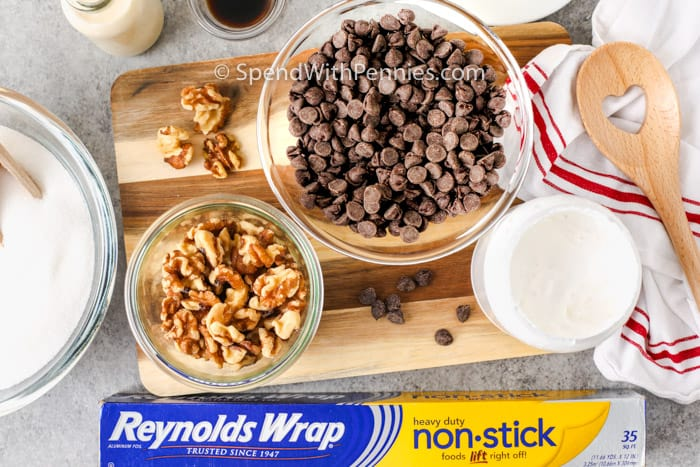 ingredients to make Fantasy Fudge in bowls with a box of reynolds wrap