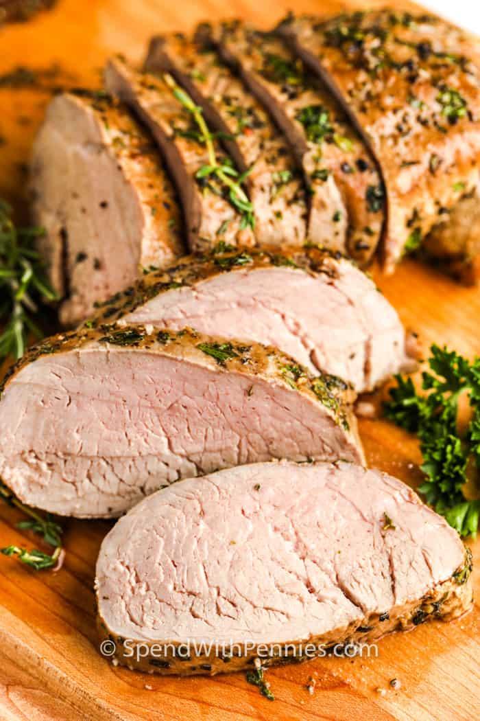 Herb Crusted Pork Tenderloin on a cutting board