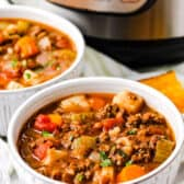 bowls of Instant Pot Lentil Soup with the instantpot in the back