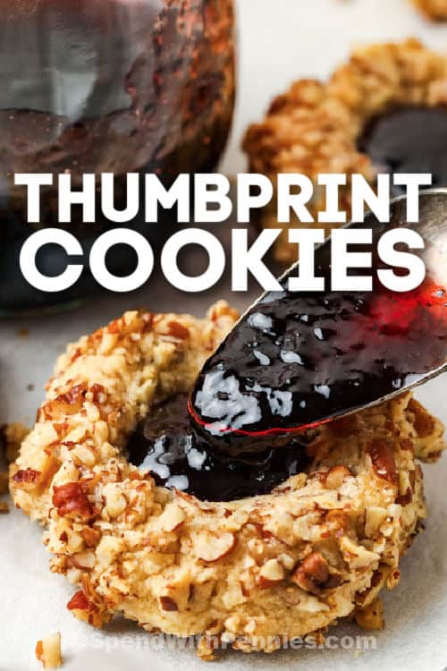 filling Classic Thumbprint Cookies with jam and a title