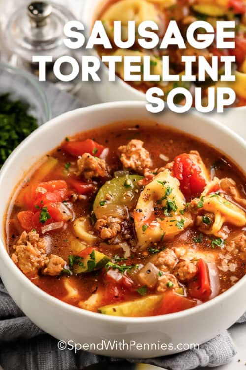 Sausage Tortellini Soup in a white bowl with a title