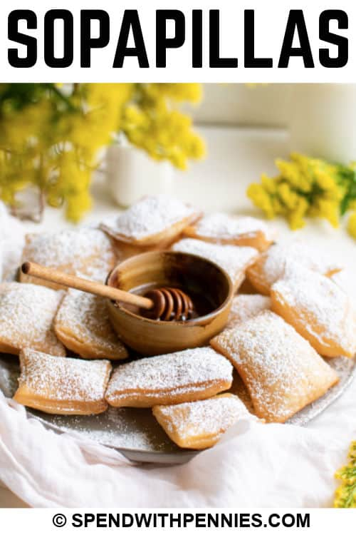 Sopapillas on a plate with writing
