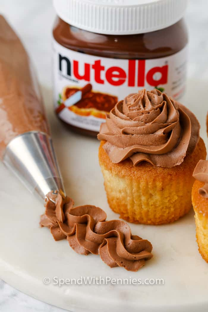 Nutella Frosting with cupcakes and the nutella jar beside it