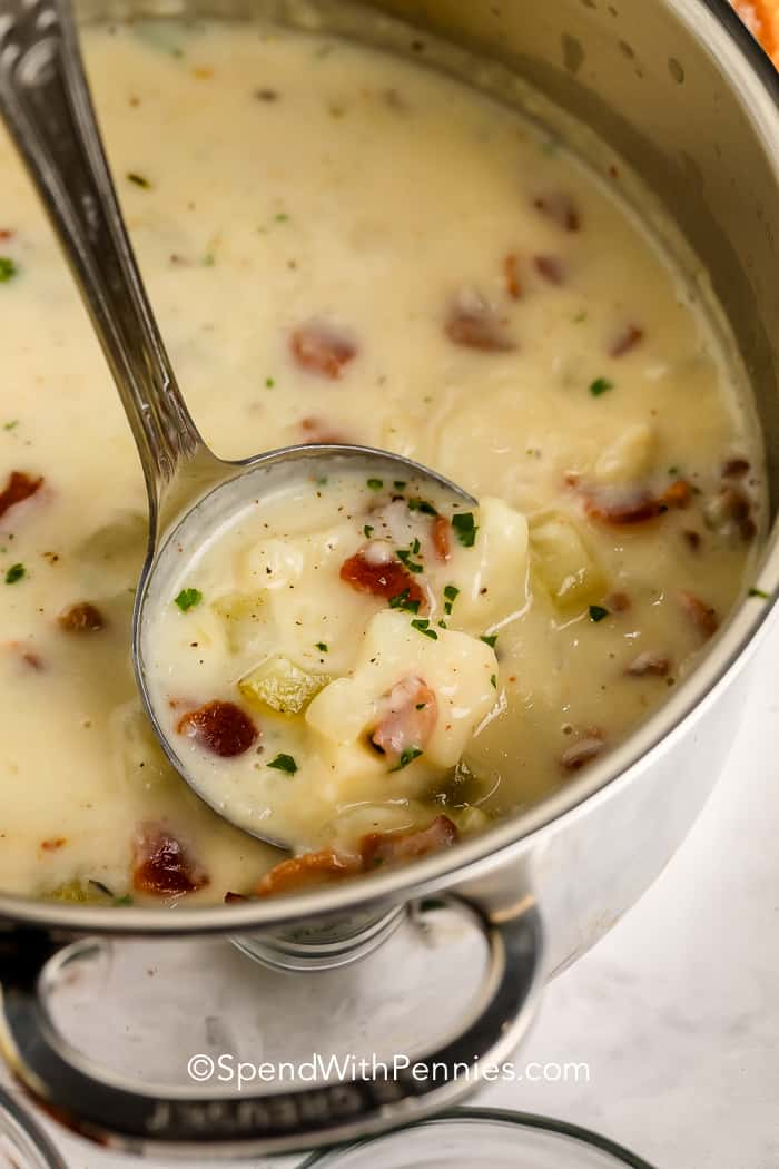 Potato Bacon Soup in a pot with a ladle