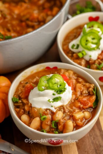 Pumpkin Chili in white bowls with sour cream