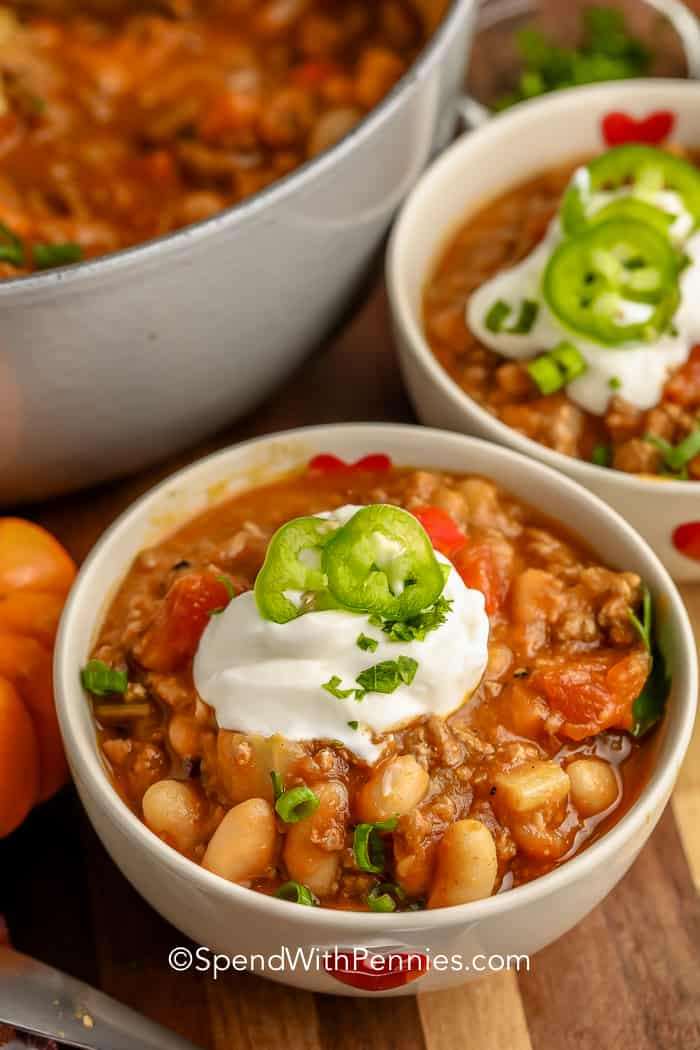 Pumpkin Chili in white bowls with sour cream
