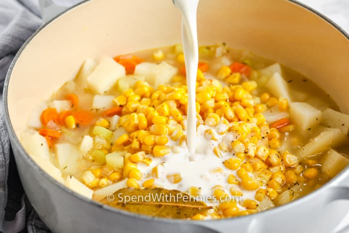 adding ingredients to pot to make Quick Potato Corn Chowder