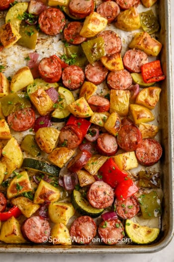 Roasted Sausage and Potatoes on a baking sheet