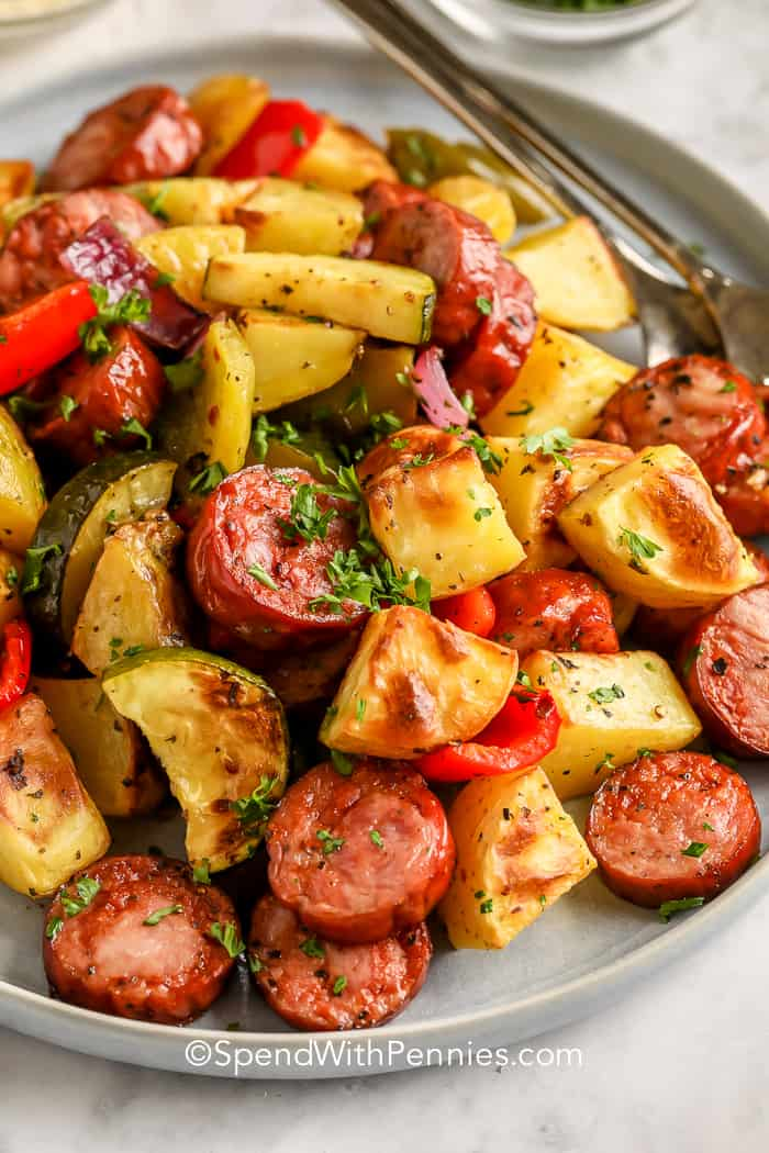 Roasted Sausage and Potatoes on a plate garnished with parsley