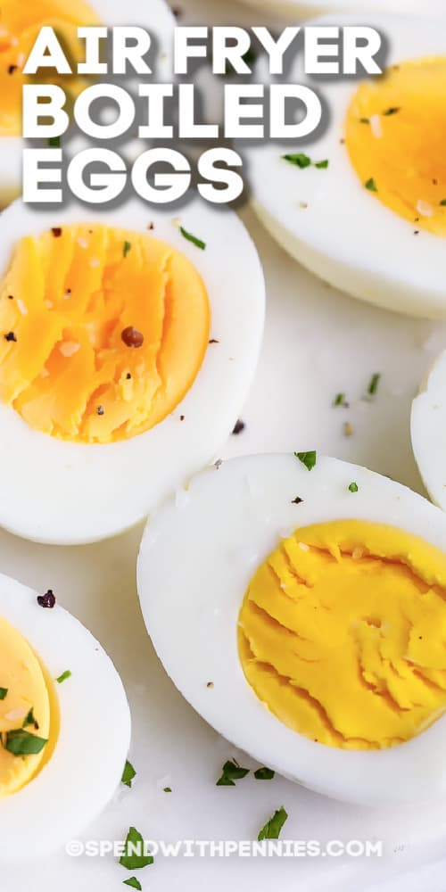 Air Fryer Boiled Eggs cut in half with parsley & pepper and a title