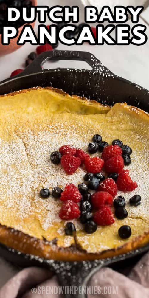 Dutch Baby pancakes cooked in a pan with berries and a title