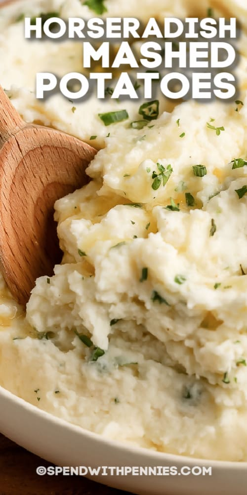 Horseradish Mashed Potatoes in a bowl with a wooden spoon and a title