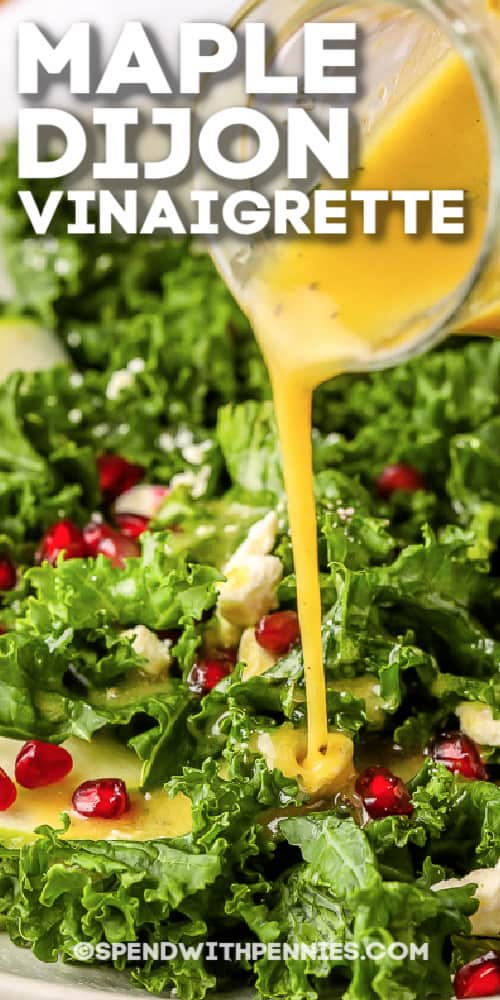 Dijon Vinaigrette being poured on a salad with writing