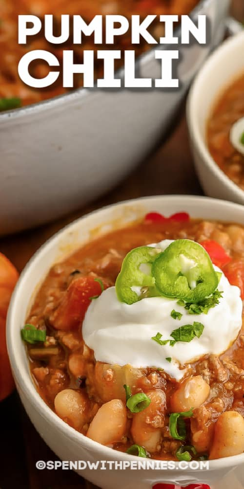 Pumpkin Chili in white bowls with writing
