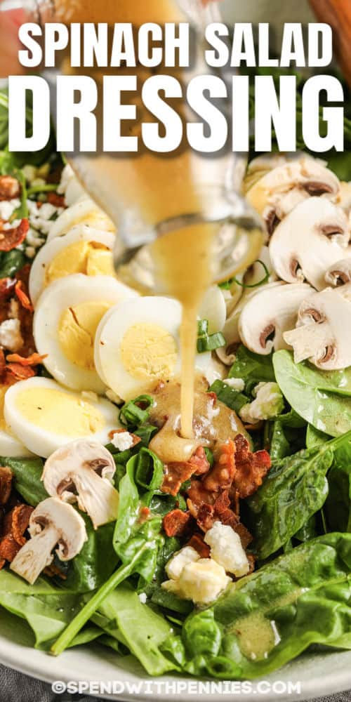 pouring Spinach Salad Dressing over salad with a title