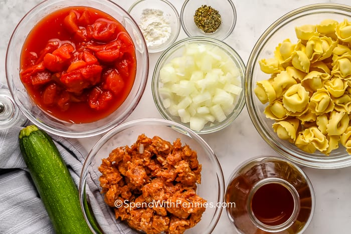 ingredients for Sausage Tortellini Soup on a marble board