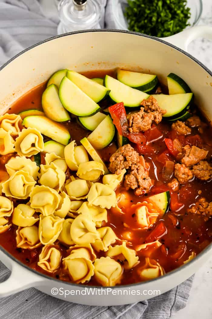 ingredients for Sausage Tortellini Soup in a pot